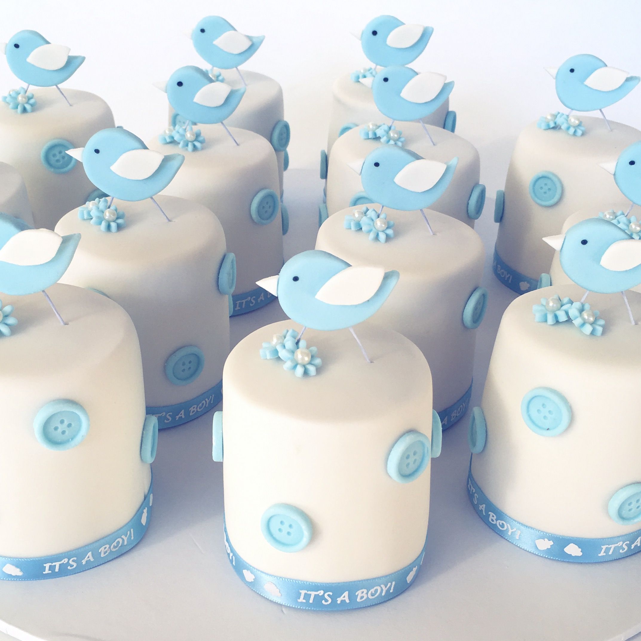 Baby blue tiny fondant cakes with birds