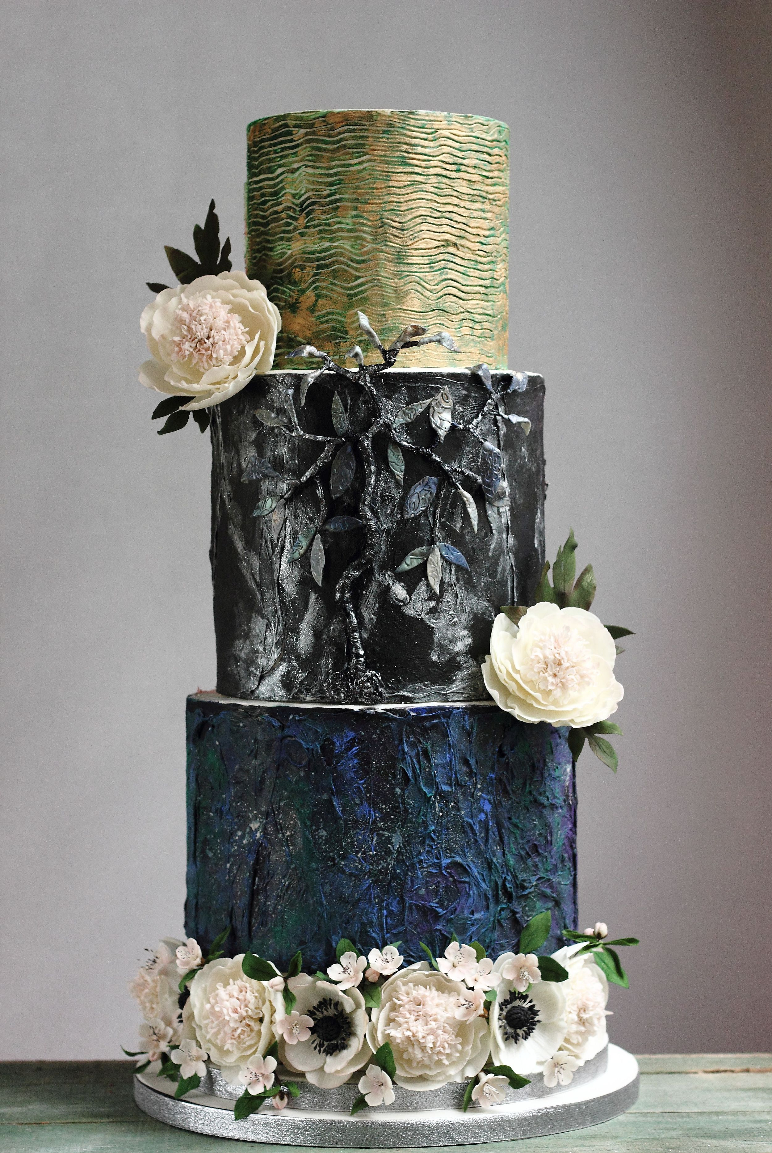 Navy blue crackle and stained glass wedding cake with sugar anemones