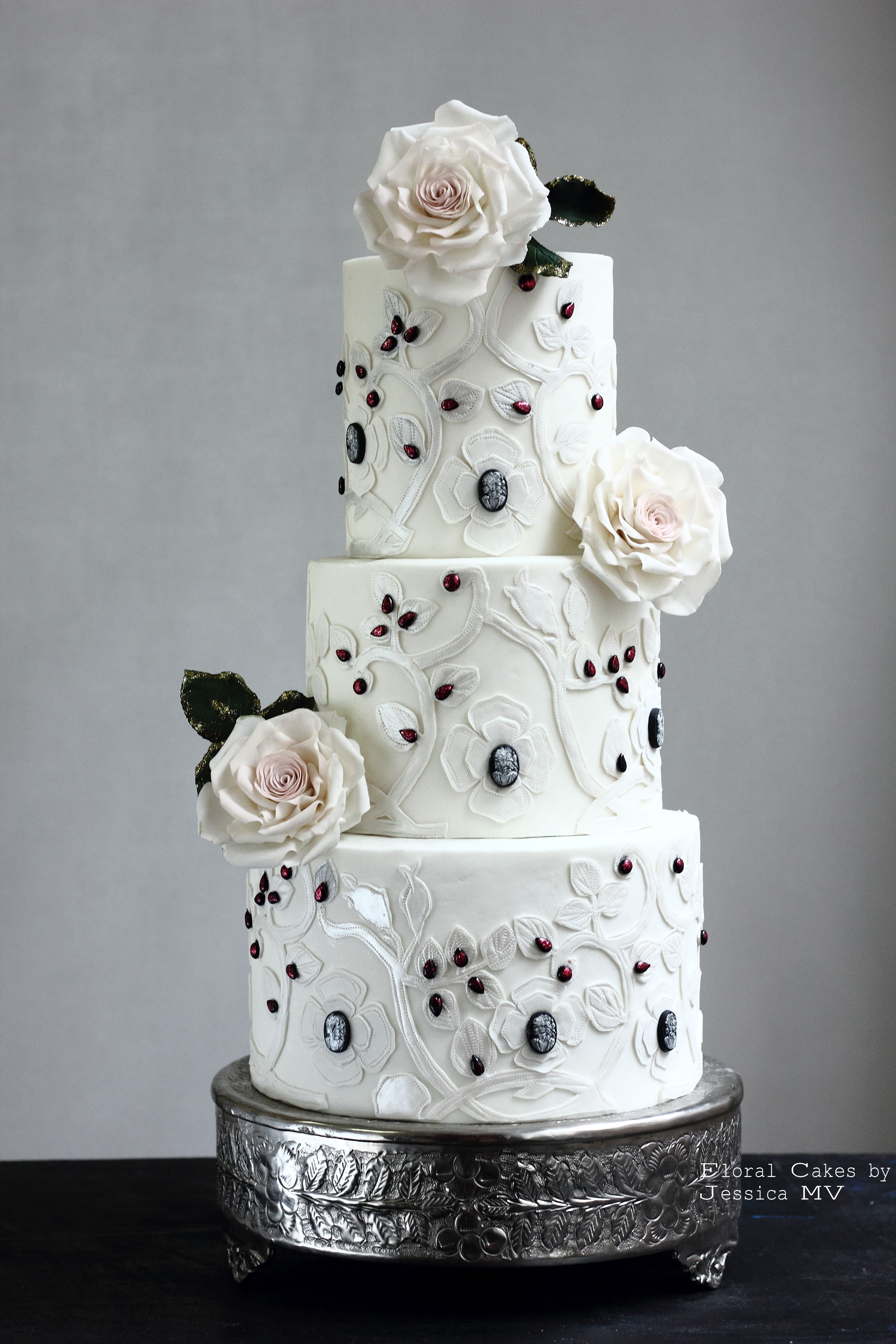 White wedding cake with black accents and sugar roses