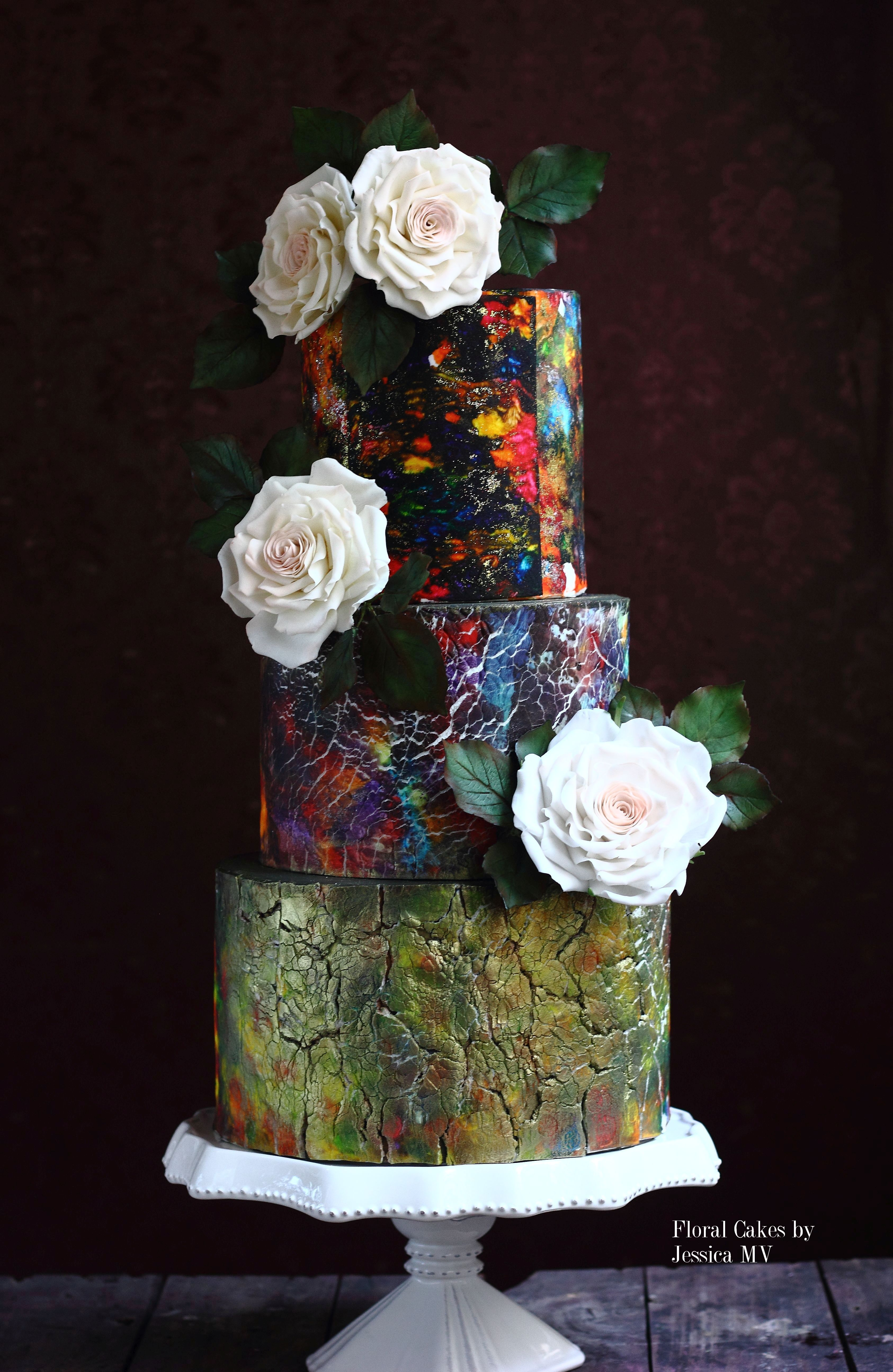 Stained glass wedding cake with sugar flowers and gold