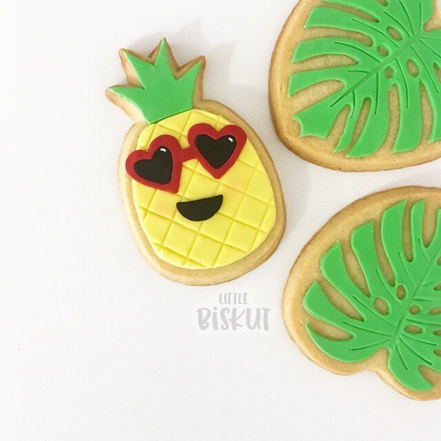 Fondant pineapple and palm tree cookies