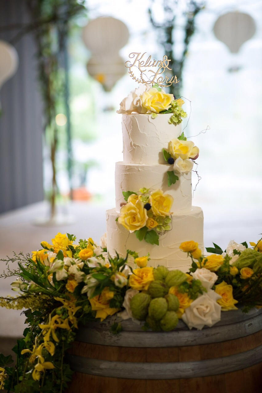 Yellow fondant wedding cake with yellow gumpaste flowers