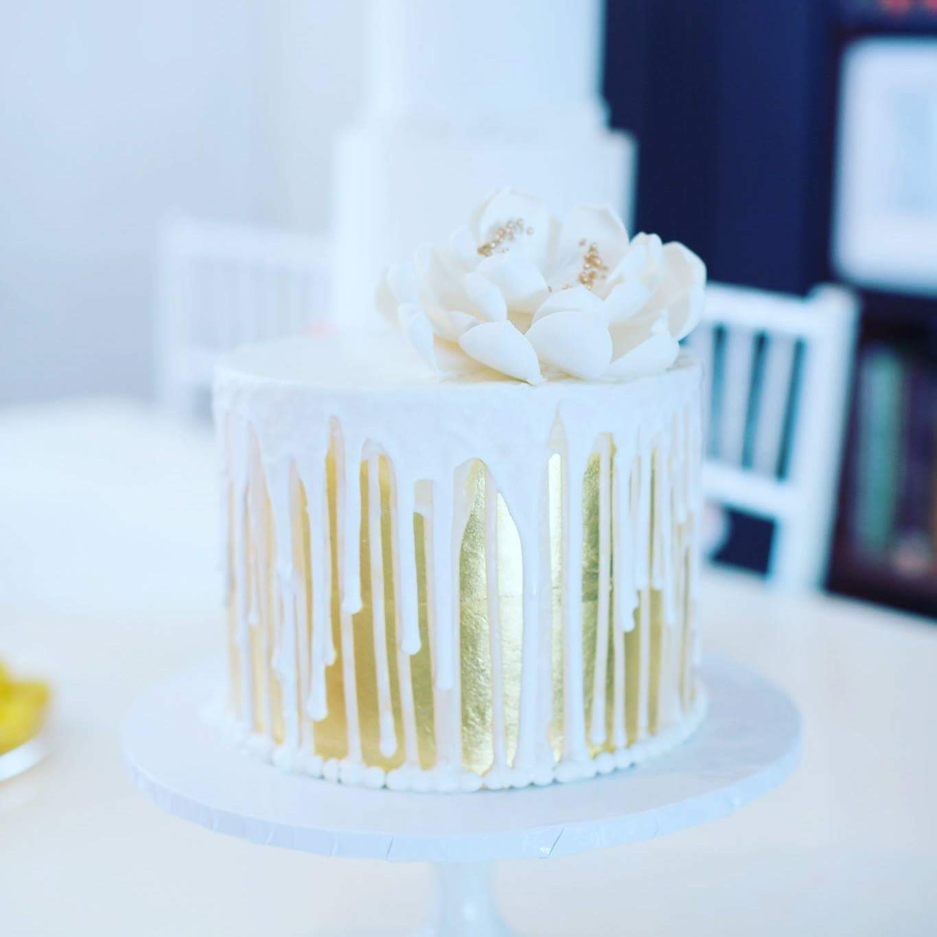 Gold and white drip cake