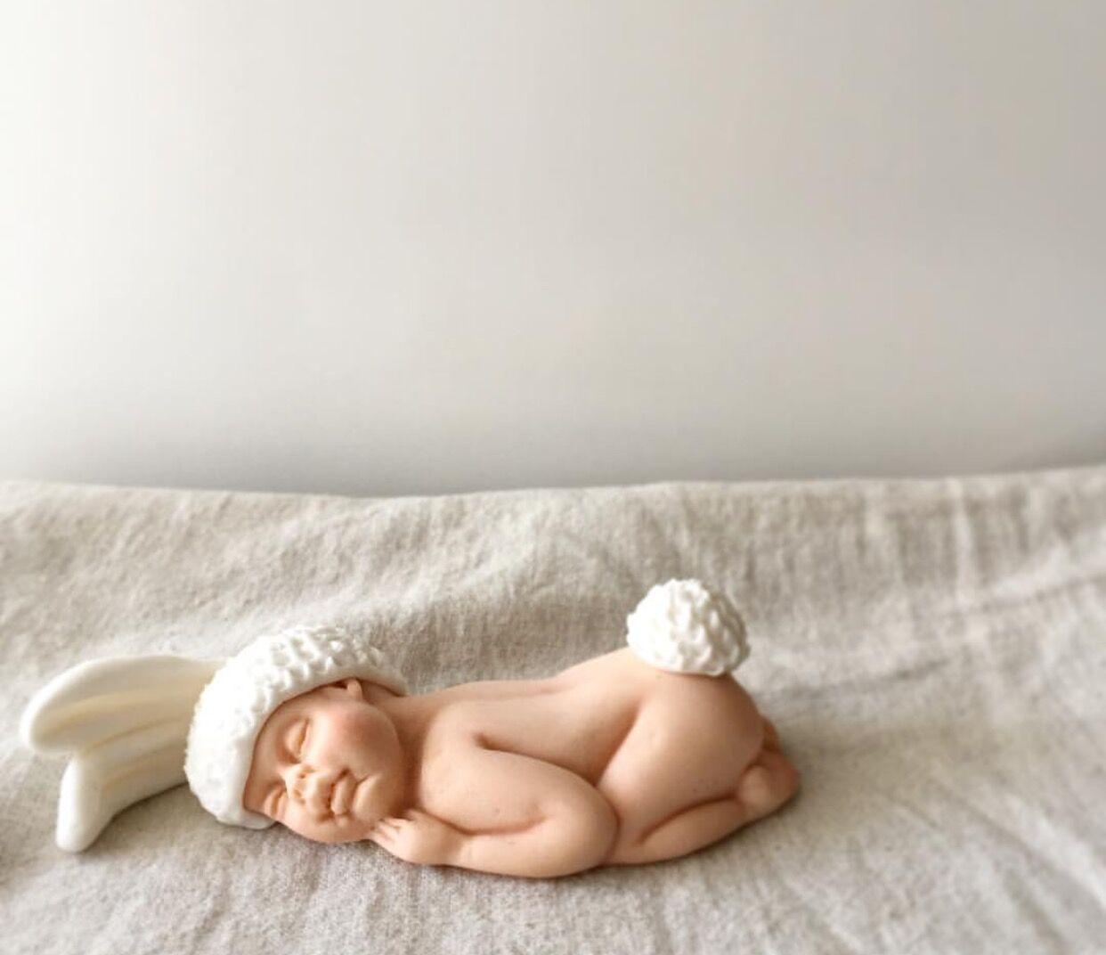 Baby fondant figurine in bunny suit