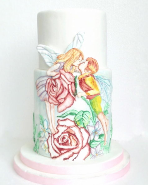 White hand painted fairy cake
