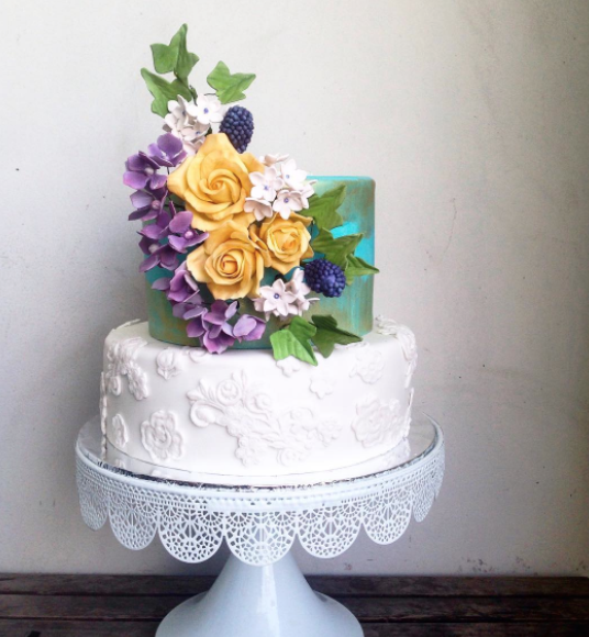 White damask wedding cake with sugar flowers