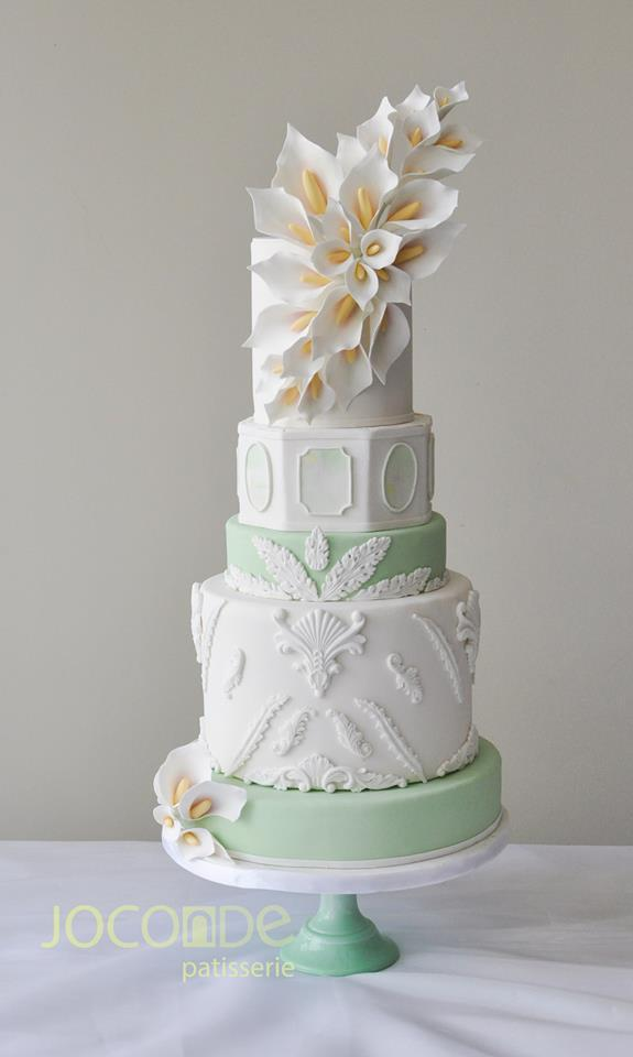 Pastel Green and white fondant wedding cake with sugar magnolias | Joconde Patisserie