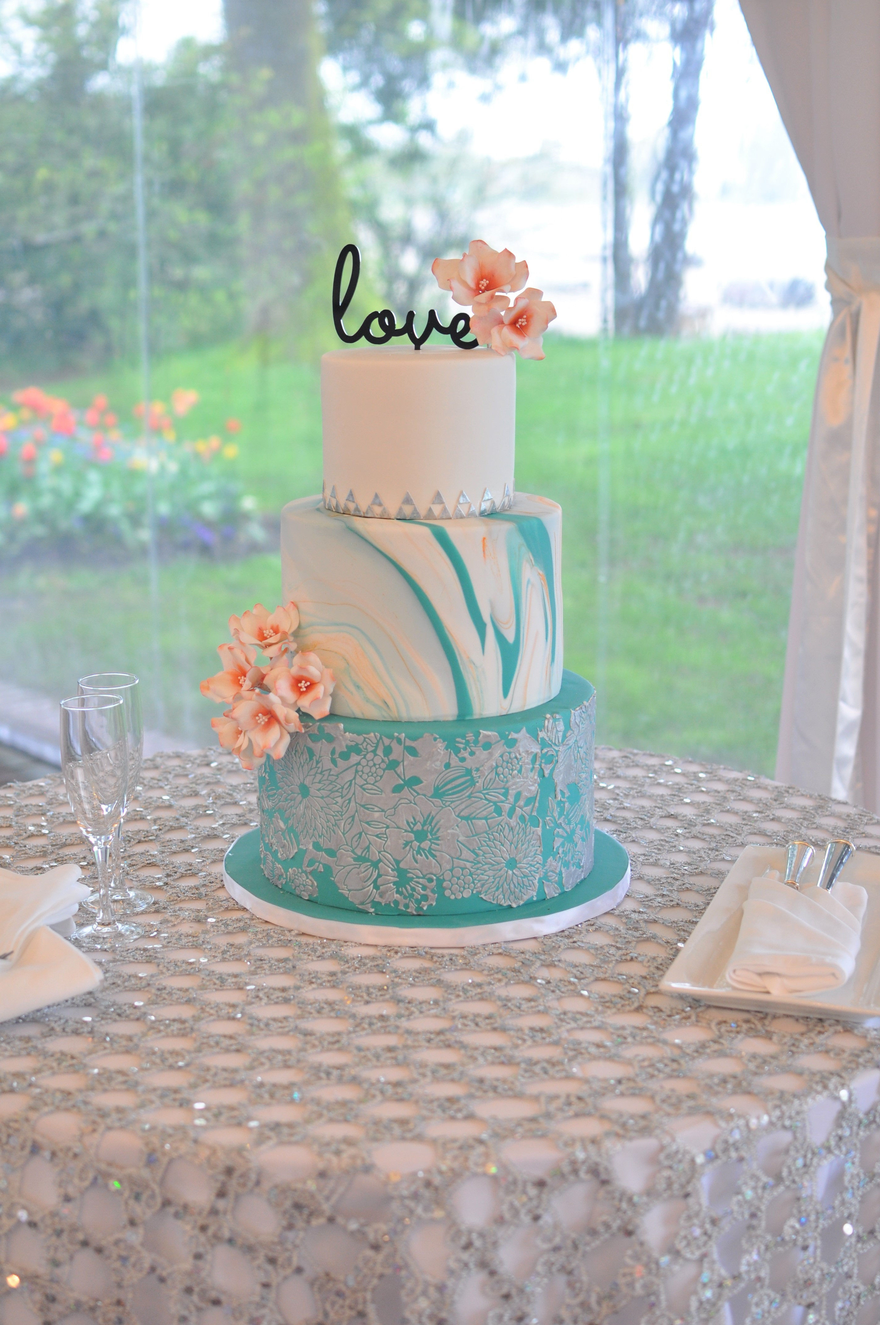 White and blue watercolor wedding cake