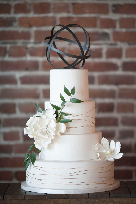 White wedding cake with white sugar flowers