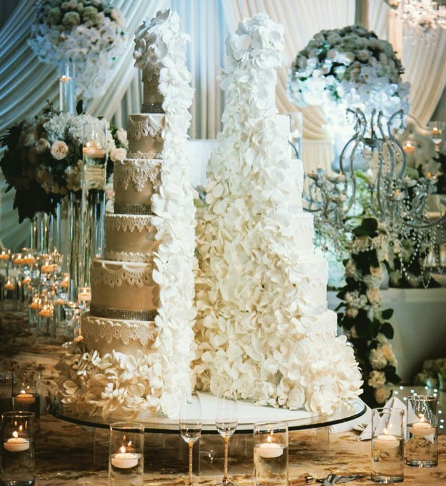 Ivory split wedding cake covered in sugar flowers