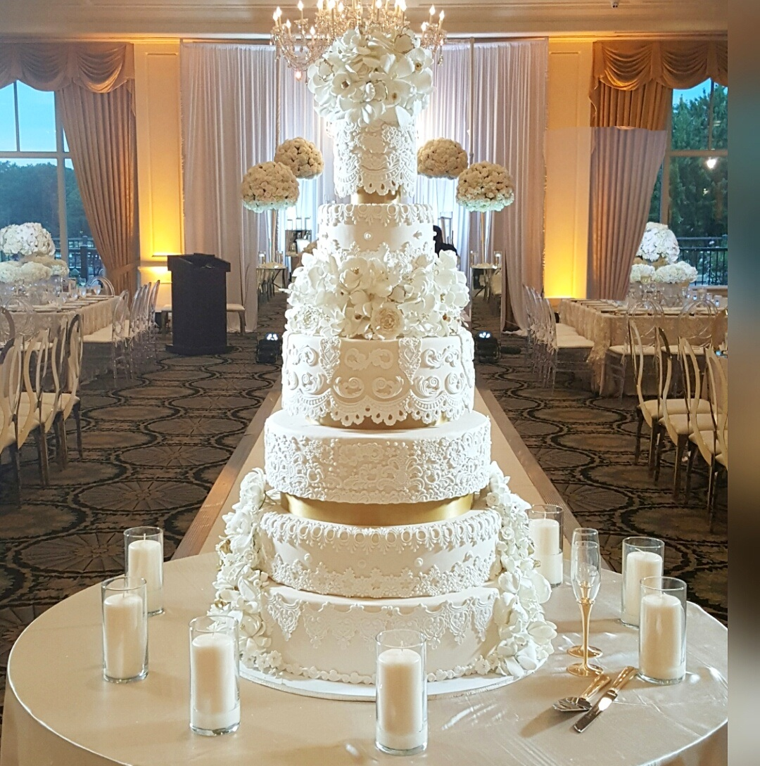 White wedding cake with gold and white sugar lace