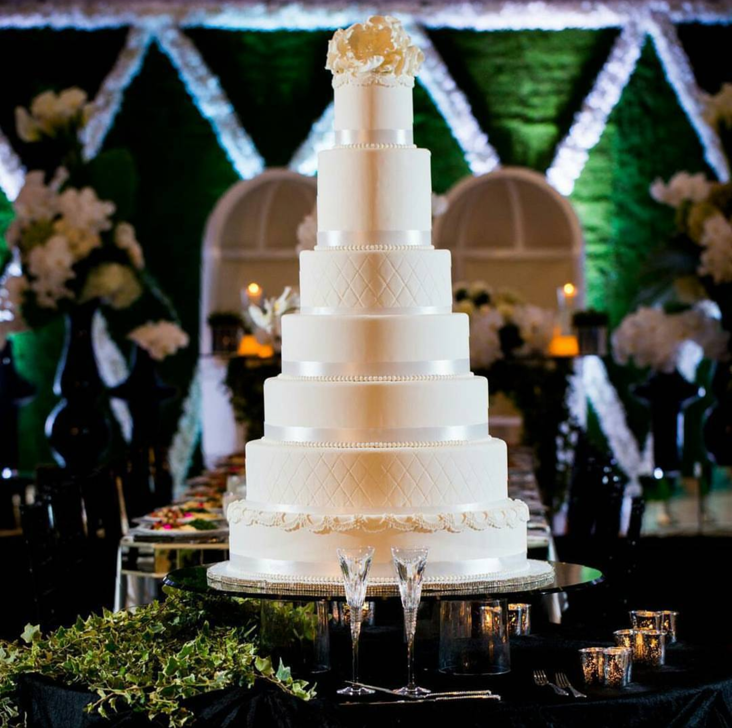 Tall Ivory wedding cake with sugar rose