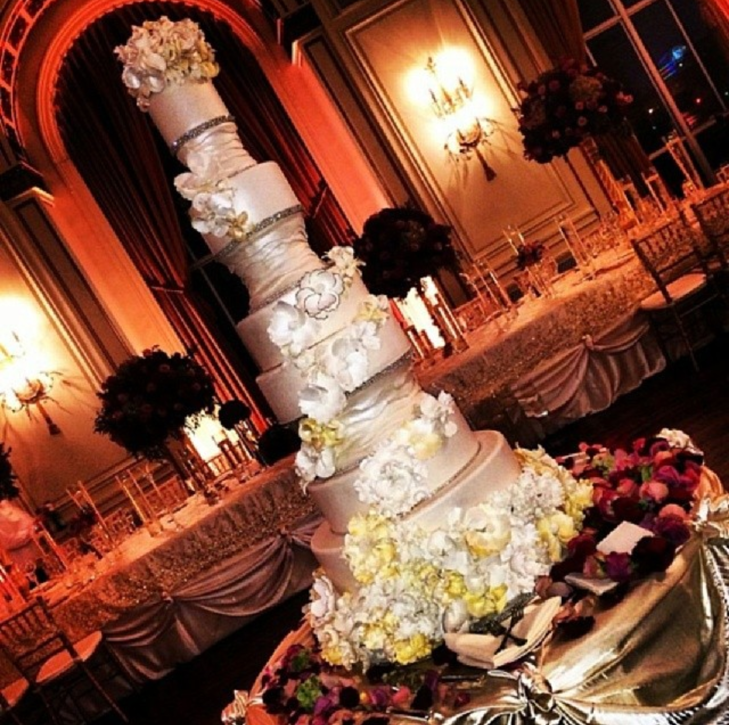 Silver wedding cake with yellow and white sugar flowers