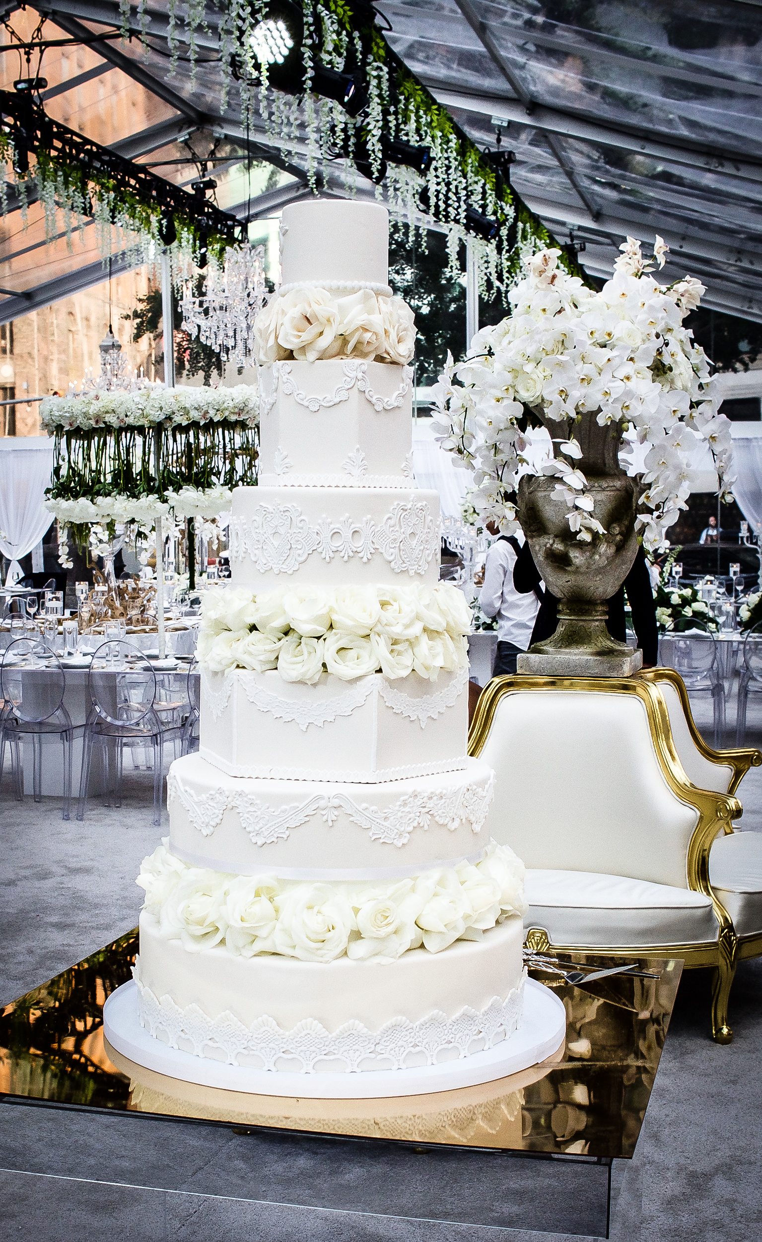 White wedding cake with white sugar roses between layers