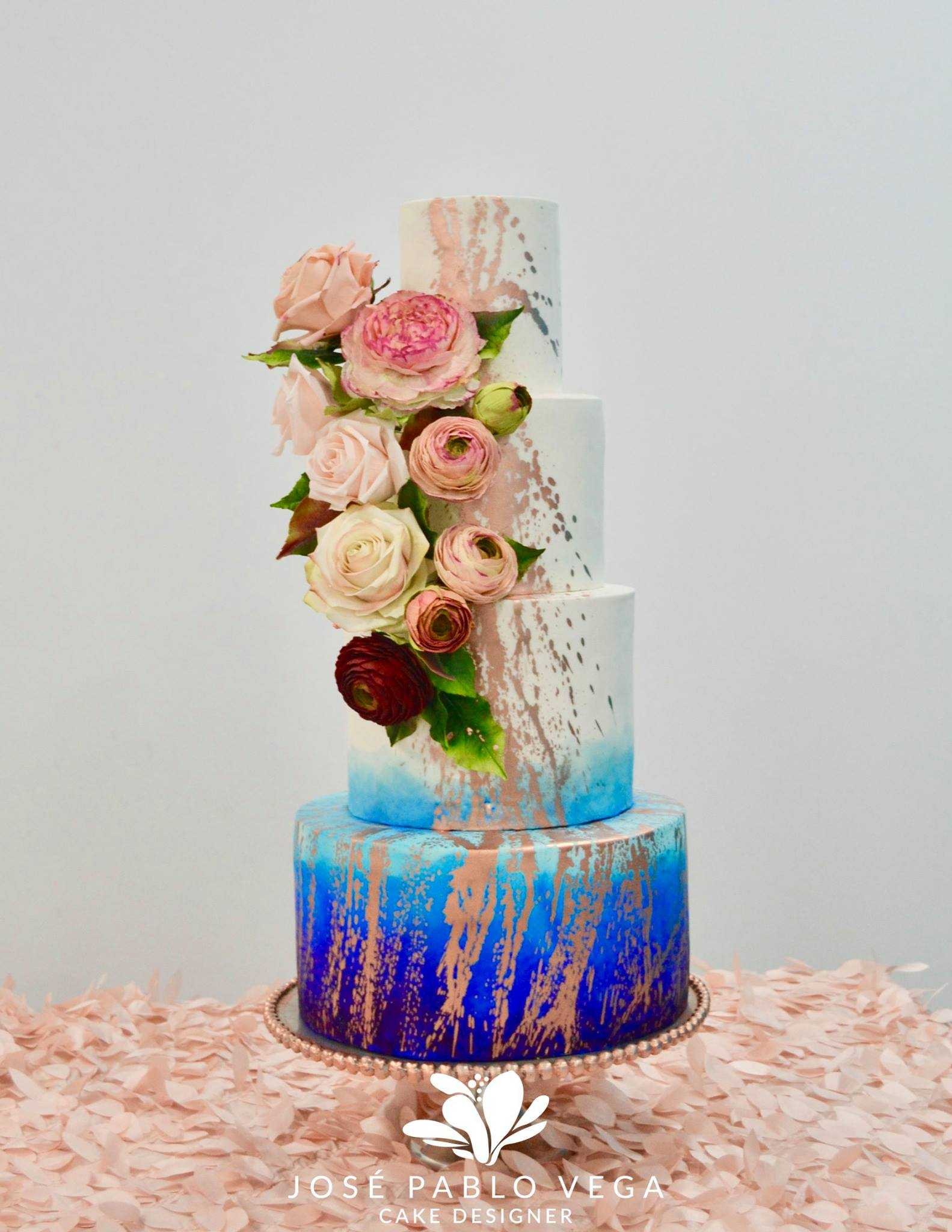 White with blue ombre wedding cake with gold splatter paint