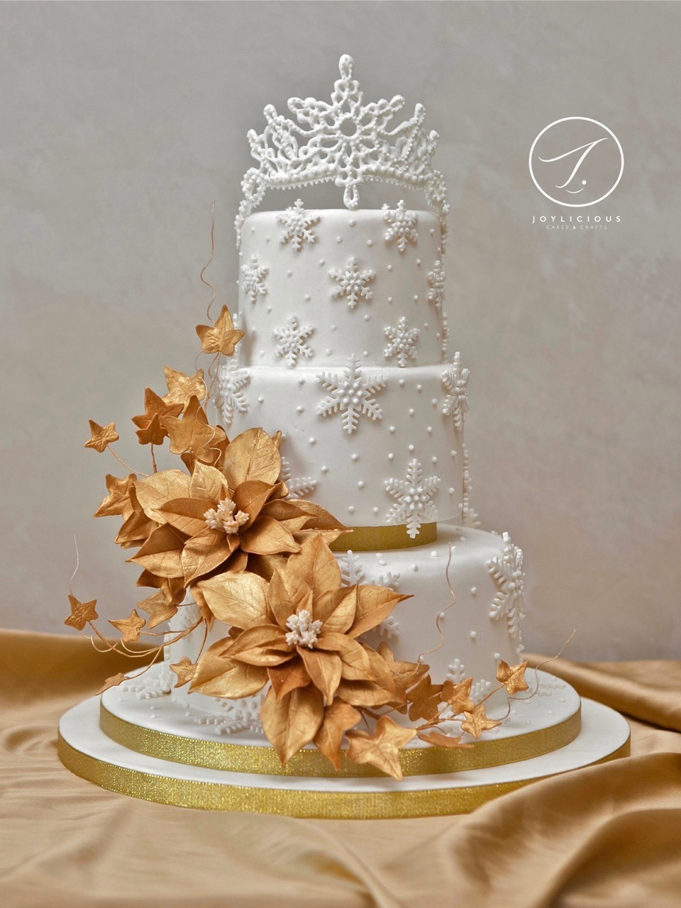 Winter gold fondant wedding cake with gold sugar flowers