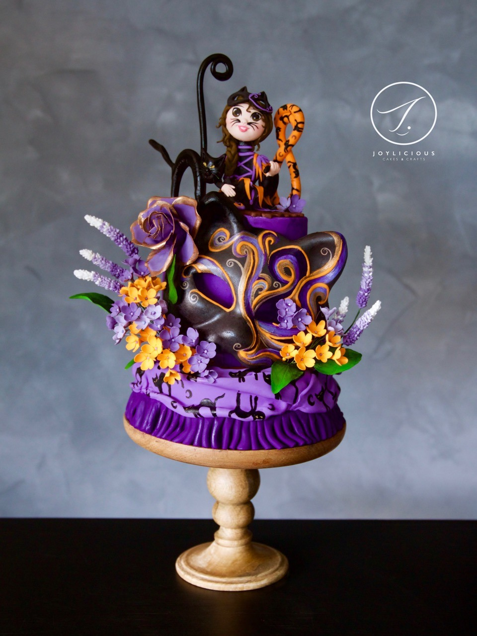 Purple fondant cake with black cat topper