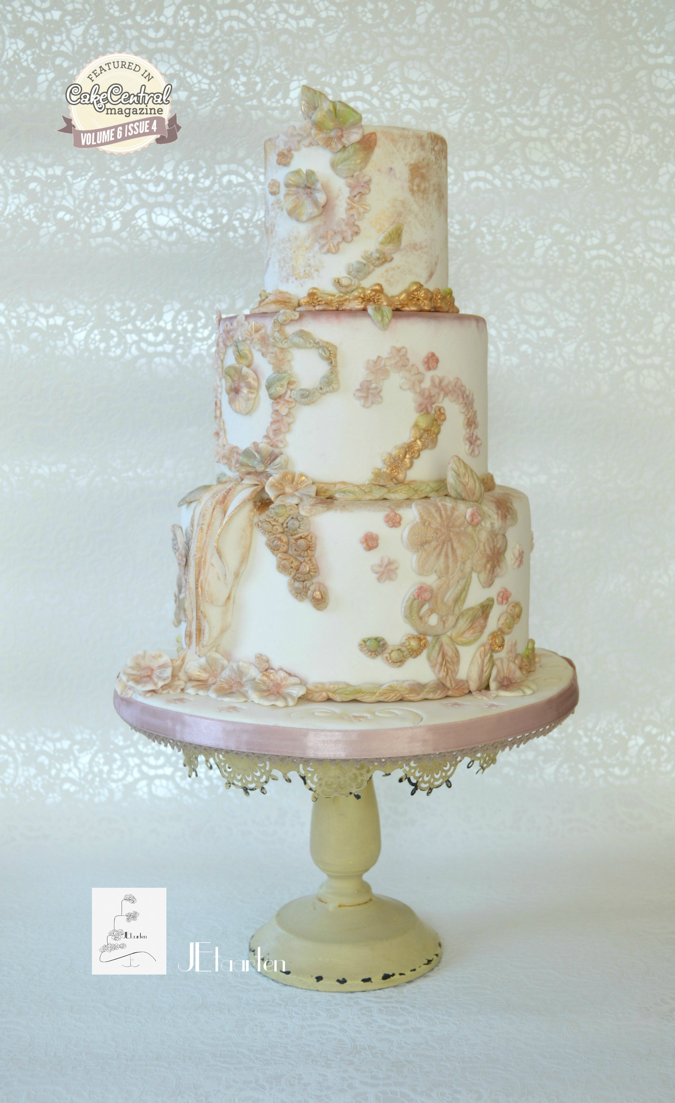 Ivory and light pink orange styled wedding cake