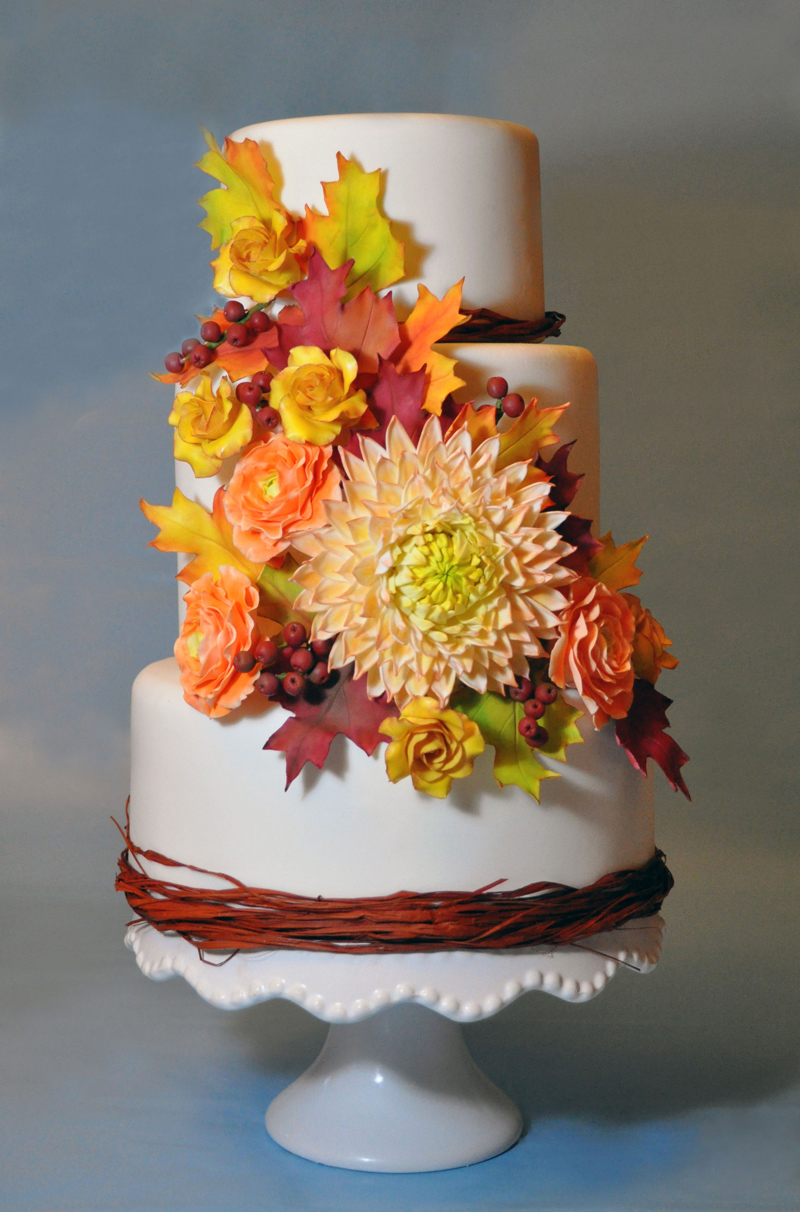 White fondant wedding cake with fall colored sugar flowers