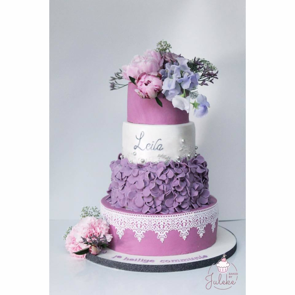Purple and white fondant cake with lavender sugar flowers