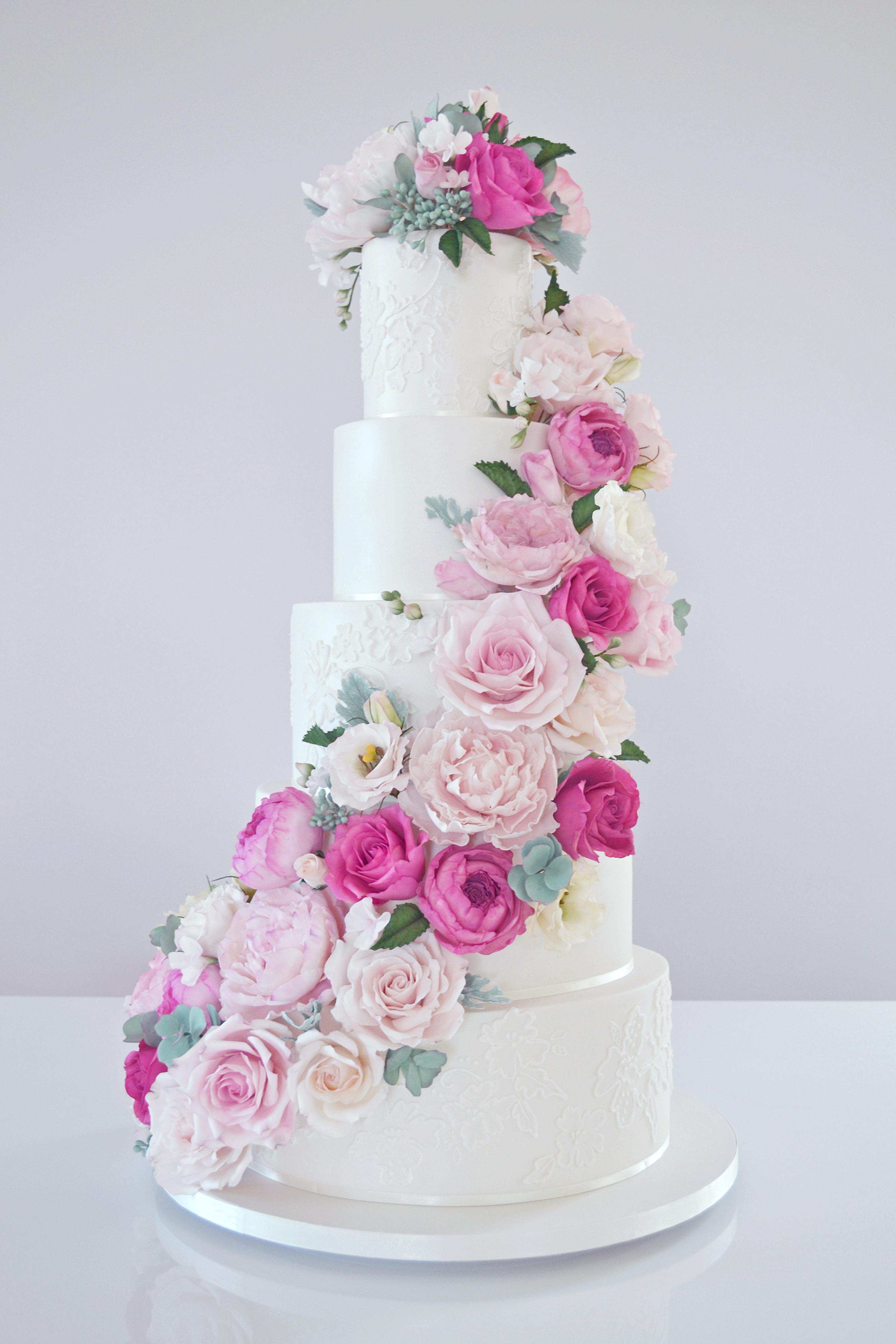 White fondant wedding cake with Cascading gum paste Pink Flowers