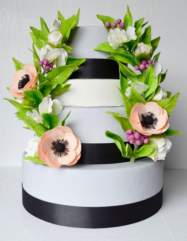 black and white wedding cake with gum paste greenery