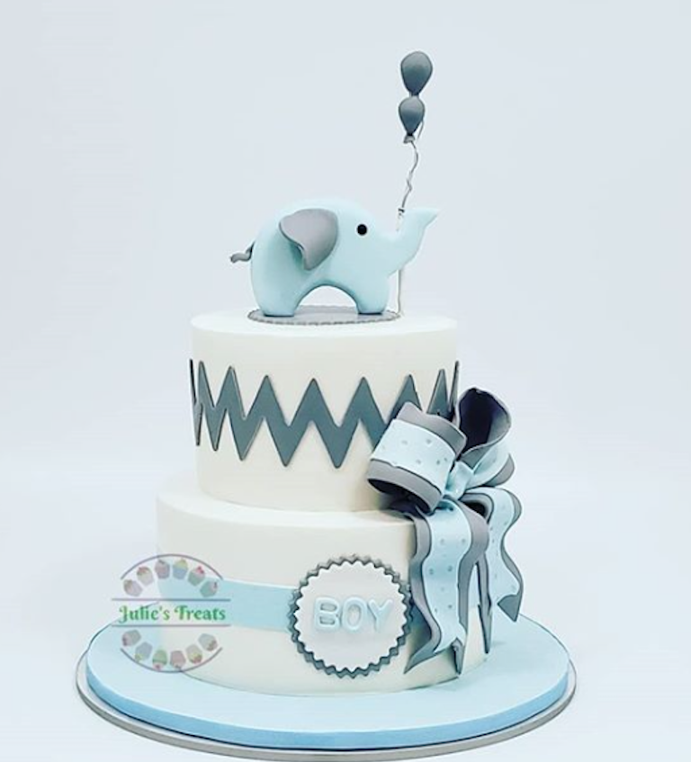 Light blue and white baby elephant fondant cake