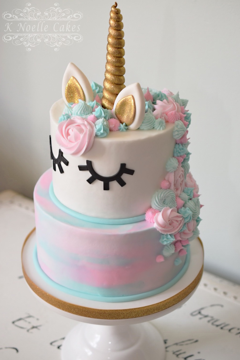 Watercolor pastel fondant unicorn birthday cake