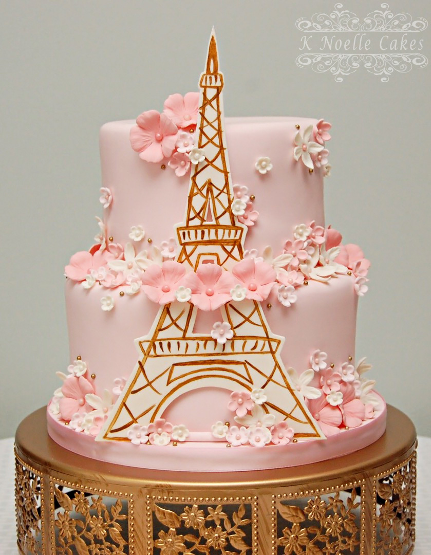 Light pink Parisian themed birthday cake