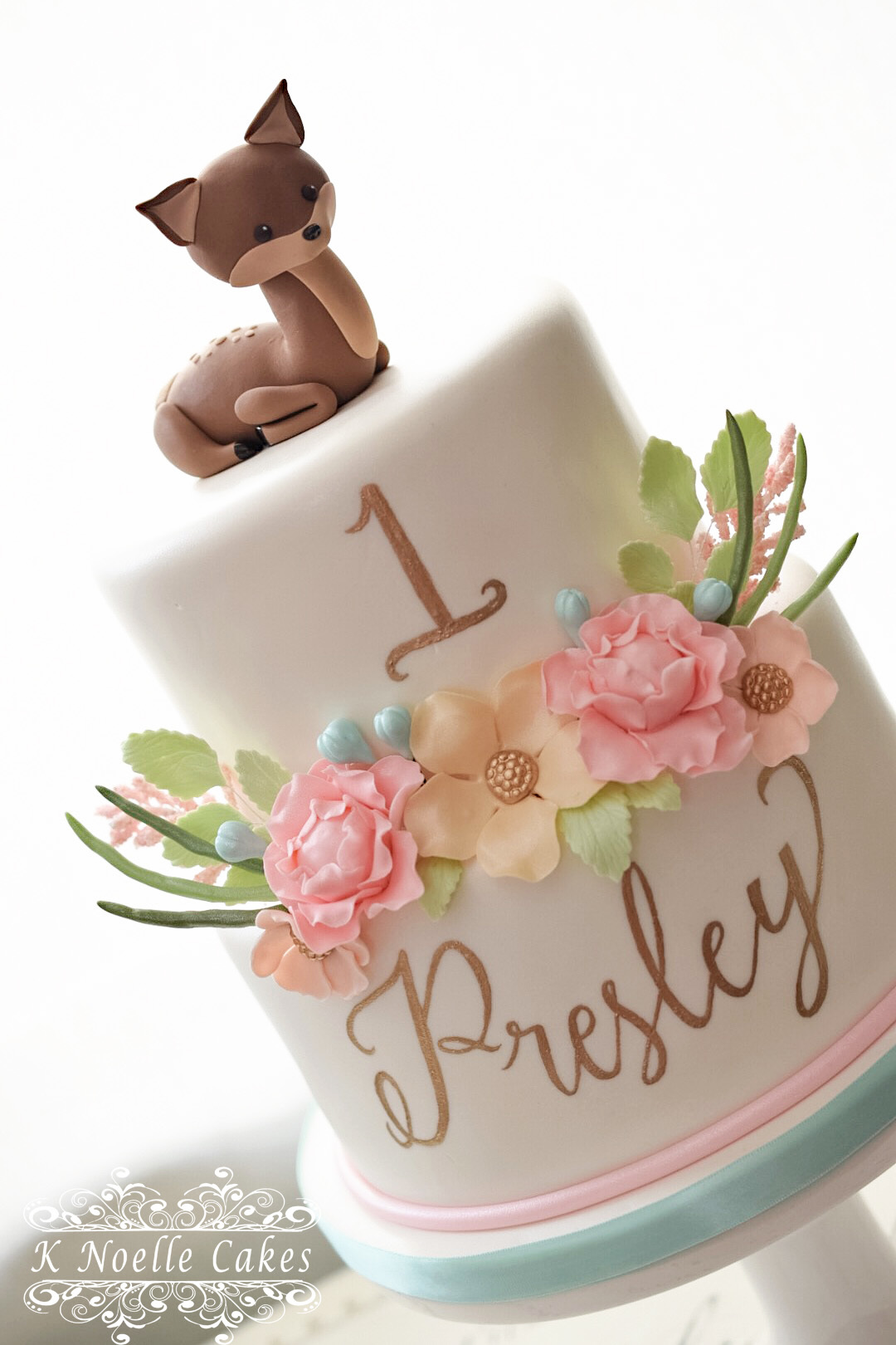 Woodland themed girls birthday cake with deer topper