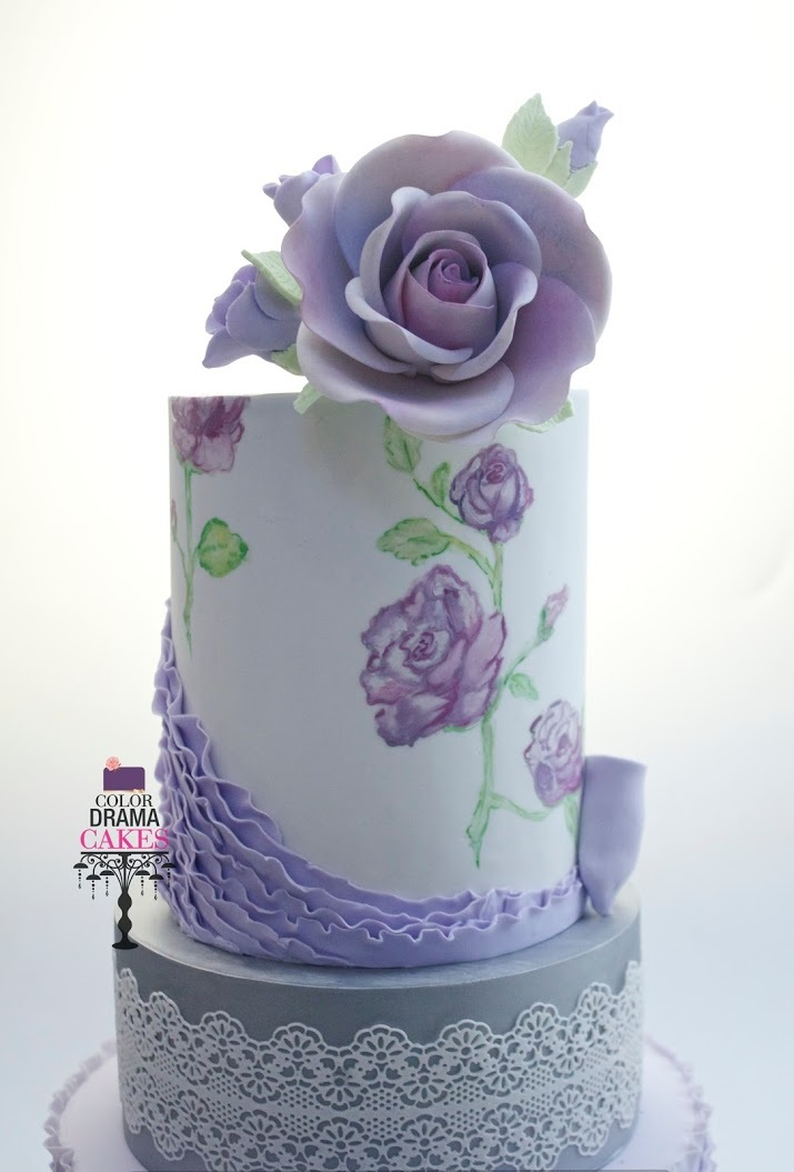 White fondant cake with lavender sugar flower