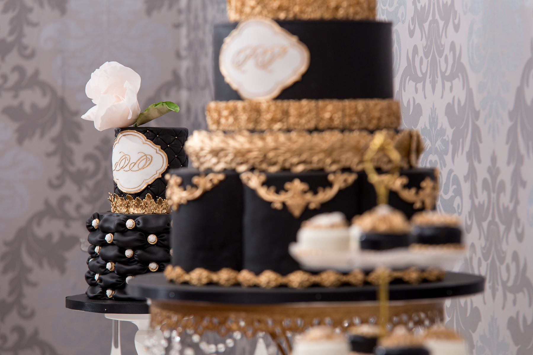 Black and gold victorian styled fondant wedding cake