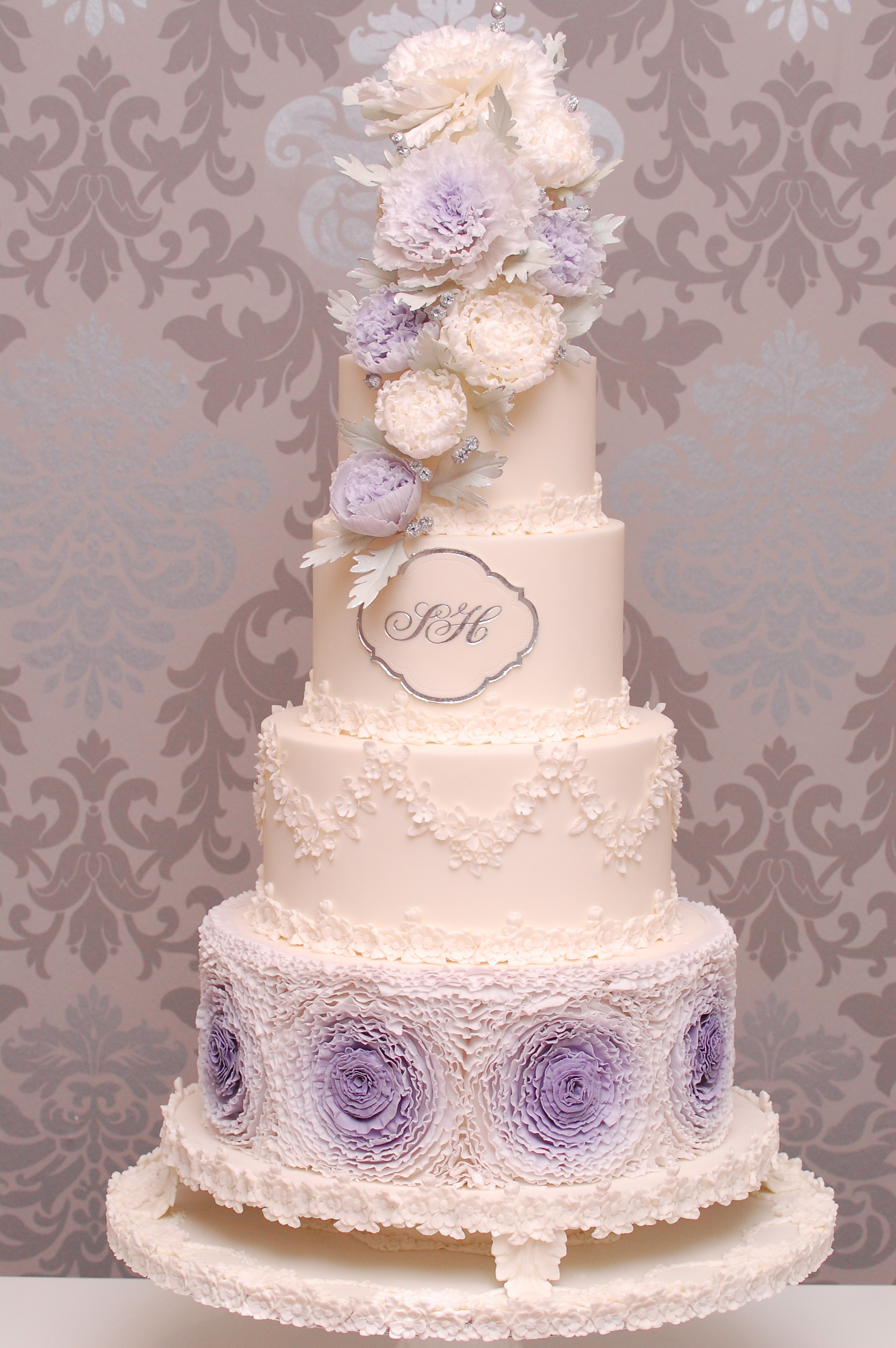 White and purple rosette wedding