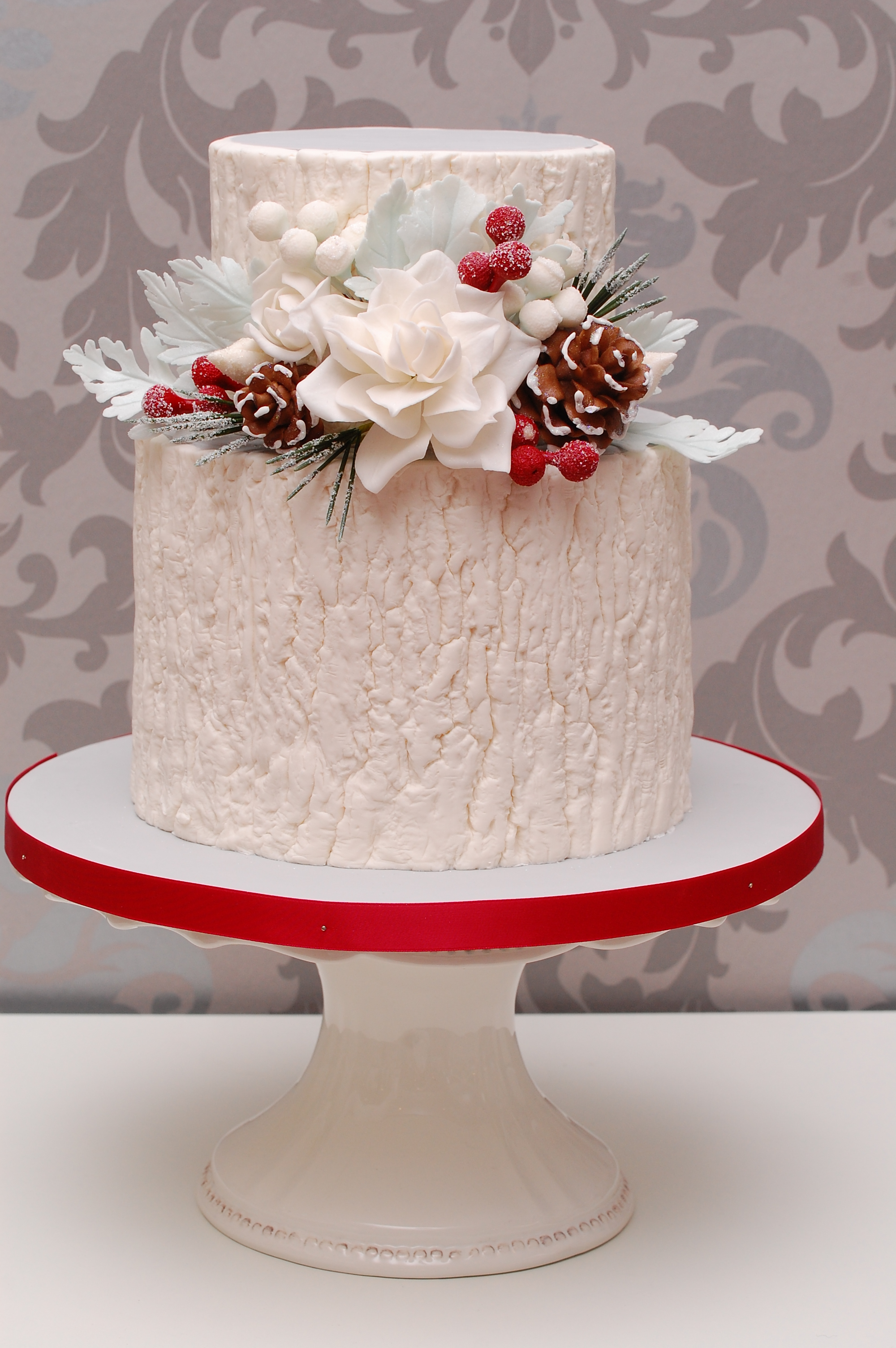 White fondant cake with poinsettia sugar flowers