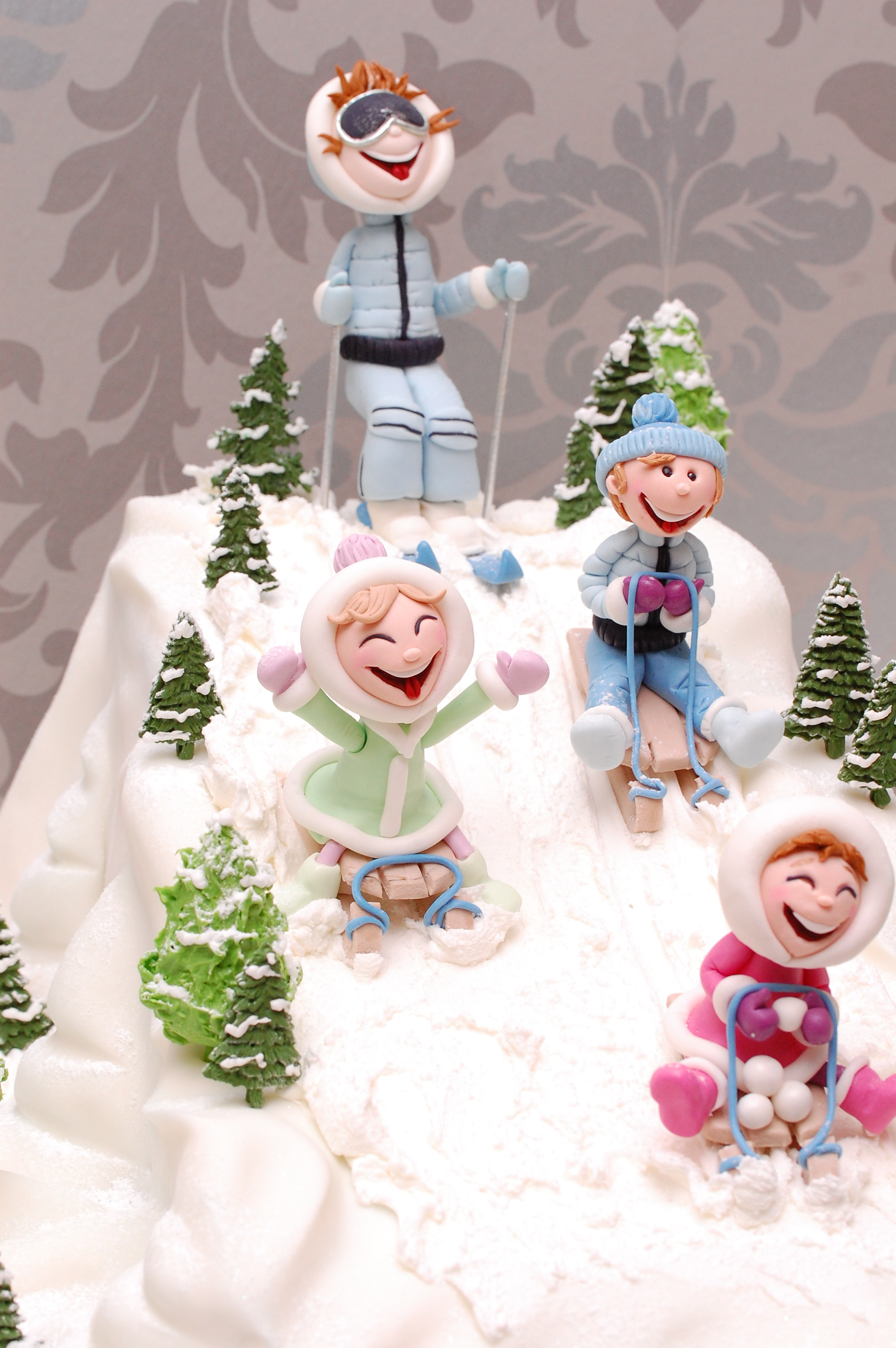 Fondant winter sledding themed birthday cake