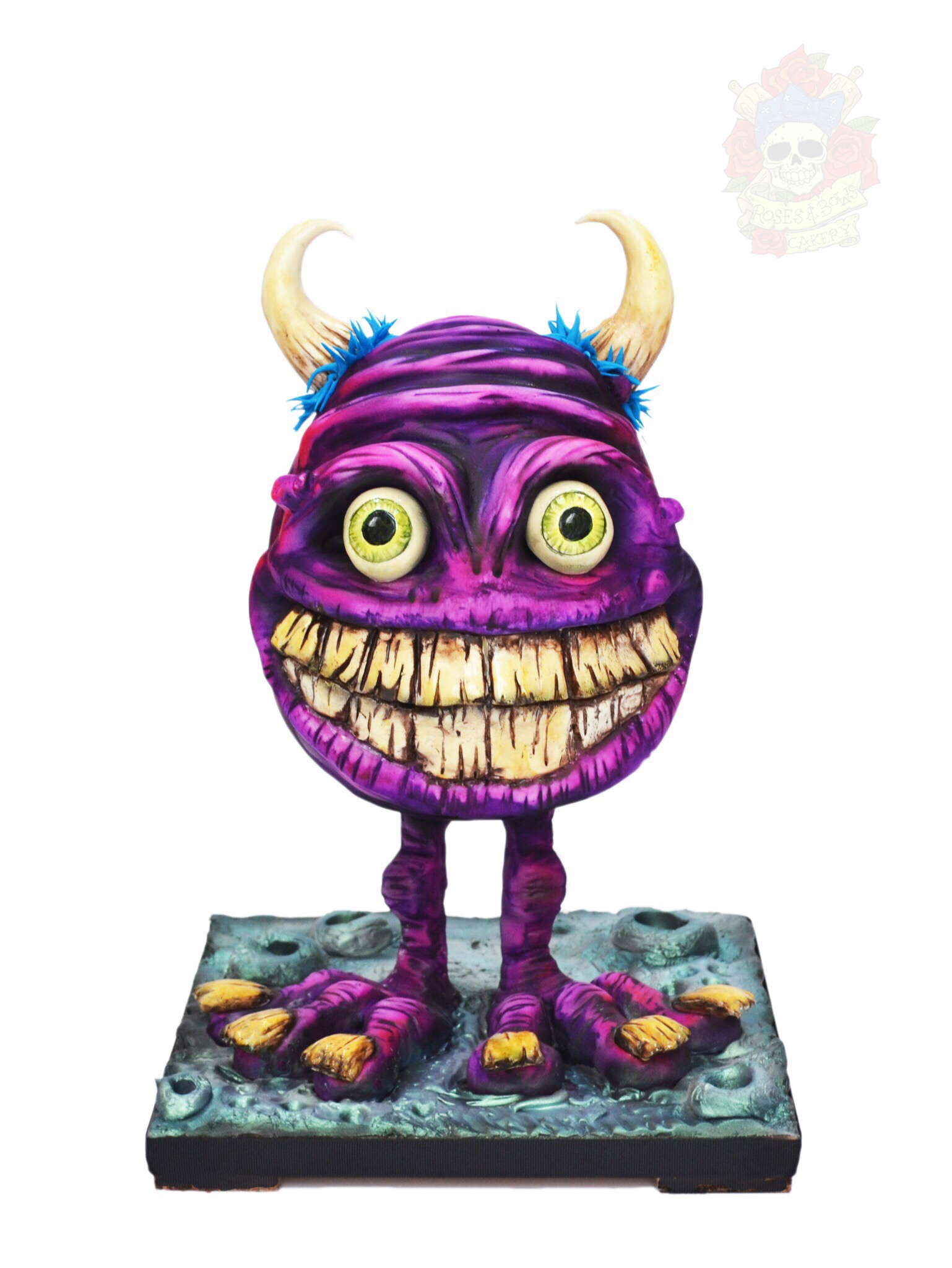 Purple fondant standing monster cake