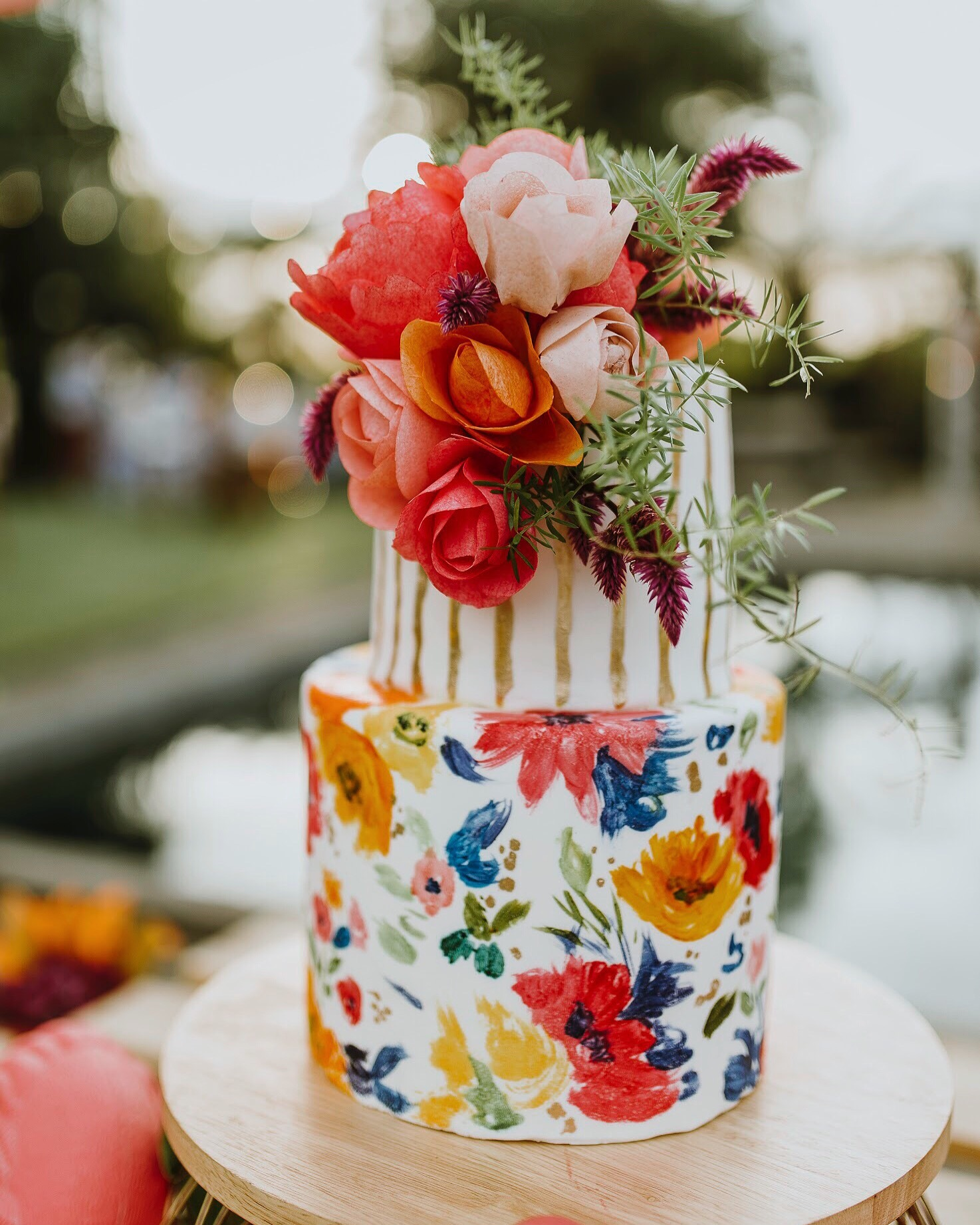 White fondant cake with hand-painted bright florals