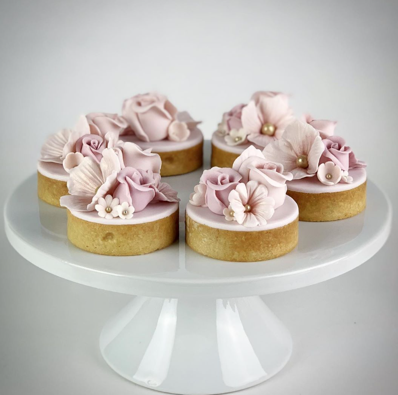 Tarts decorated with gum paste pink flowers