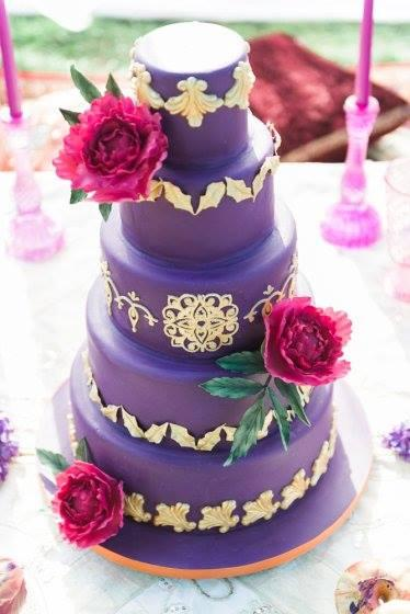 Purple wedding cake with gold trim
