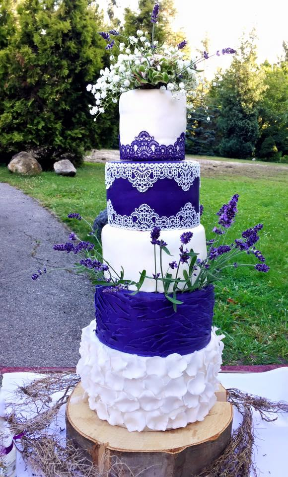 Purple and white ruffle wedding cake
