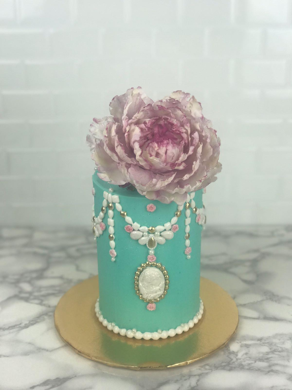 Vintage mini turquoise wedding cake with sugar pearls and flower