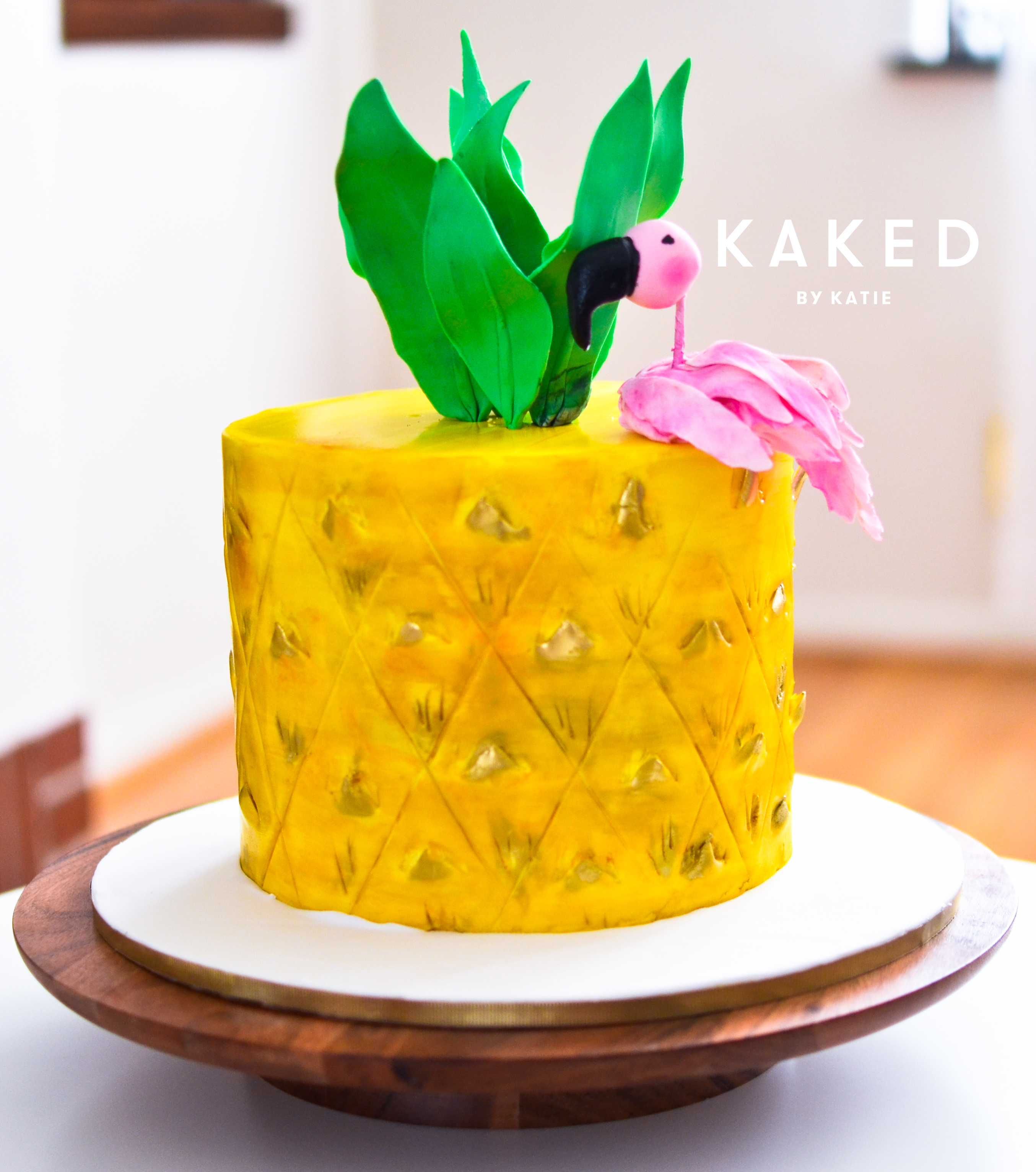 Mini fondant pineapple shaped cake with flamingo