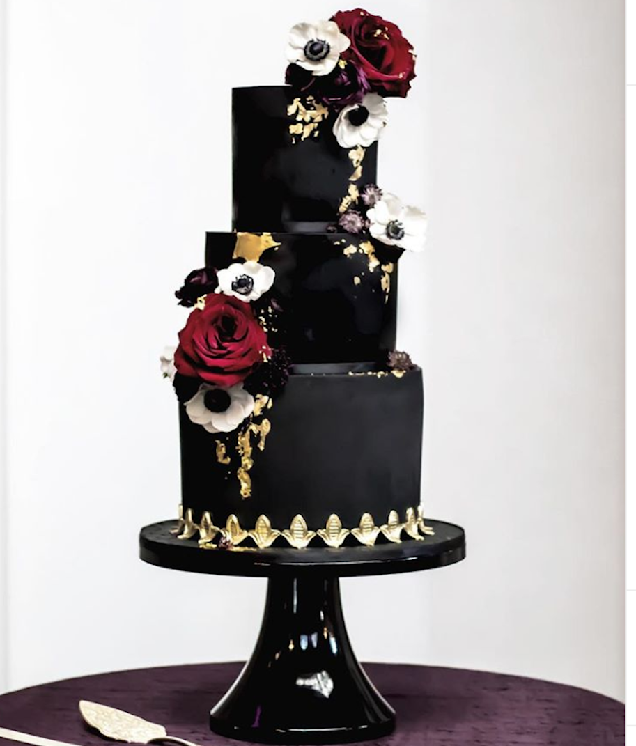 Elegant black fondant wedding cake with dark sugar flowers