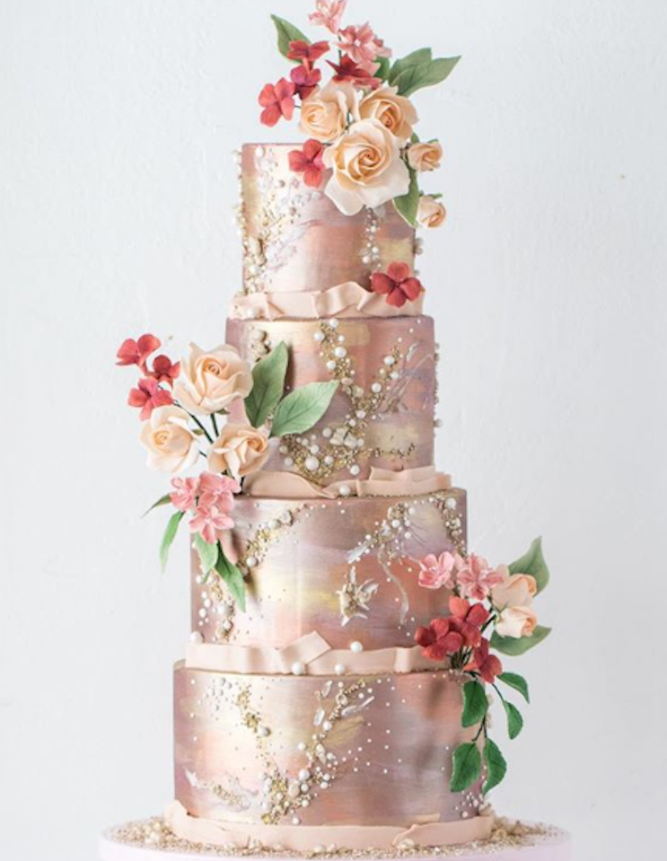 Rose gold fondant wedding cake with gum paste flowers
