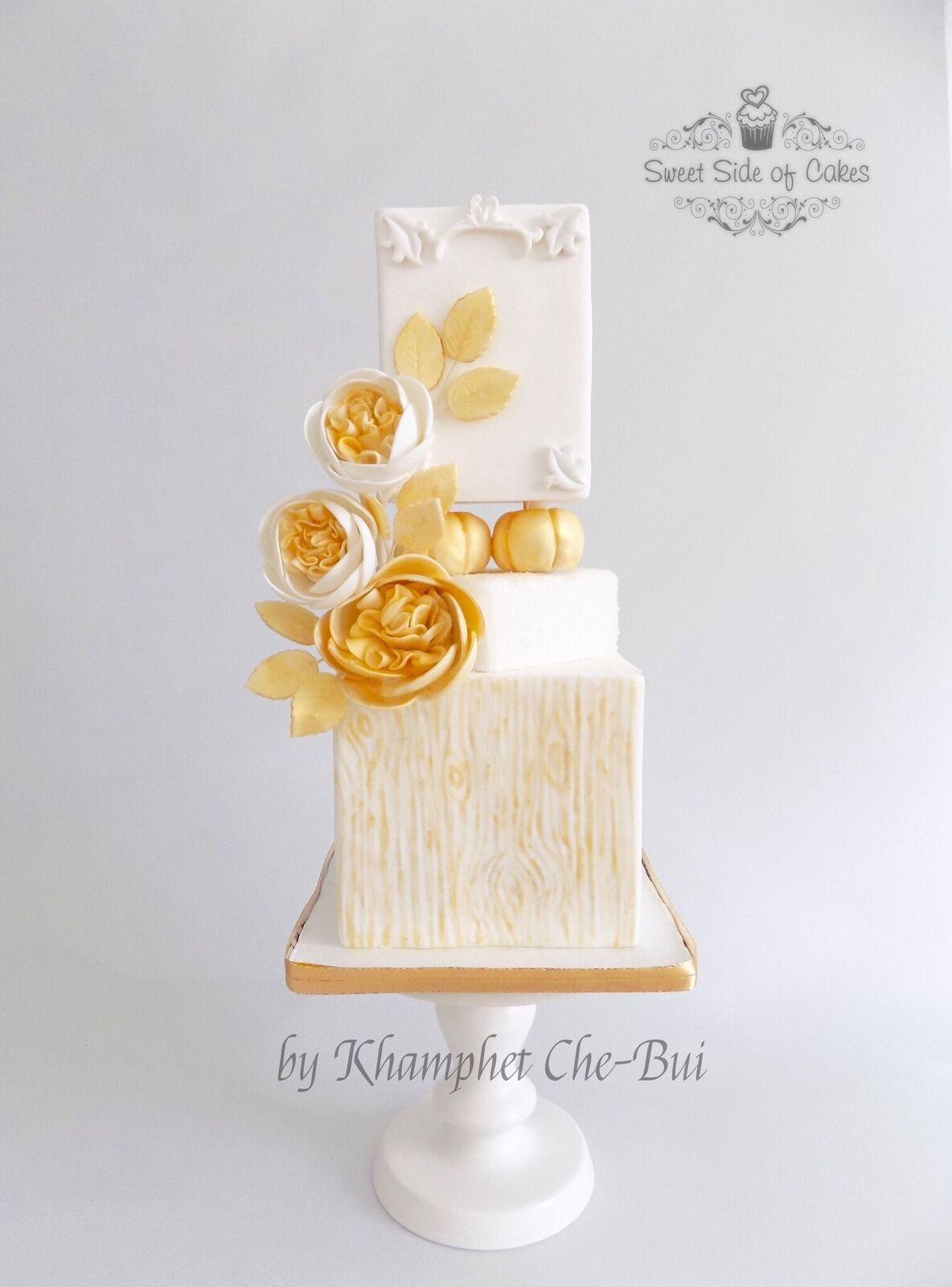 Ivory and gold sugar flower wedding cake