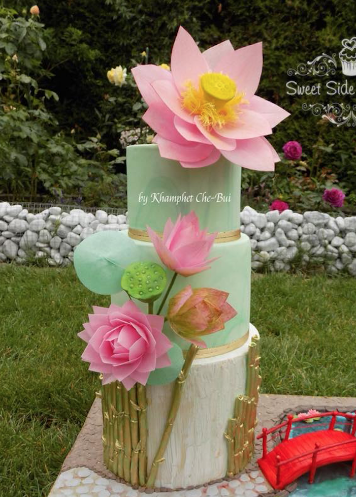 Pastel green wedding cake with pink sugar flowers