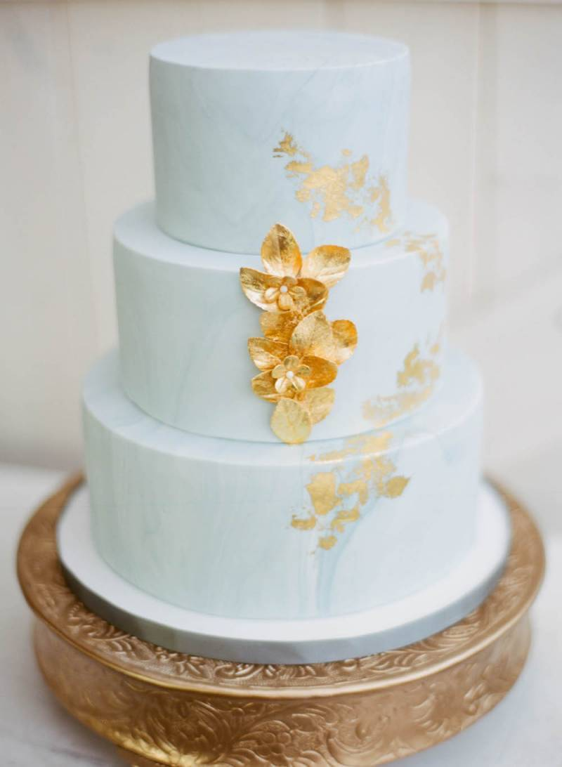 Baby blue and with gold leaf fondant wedding cake