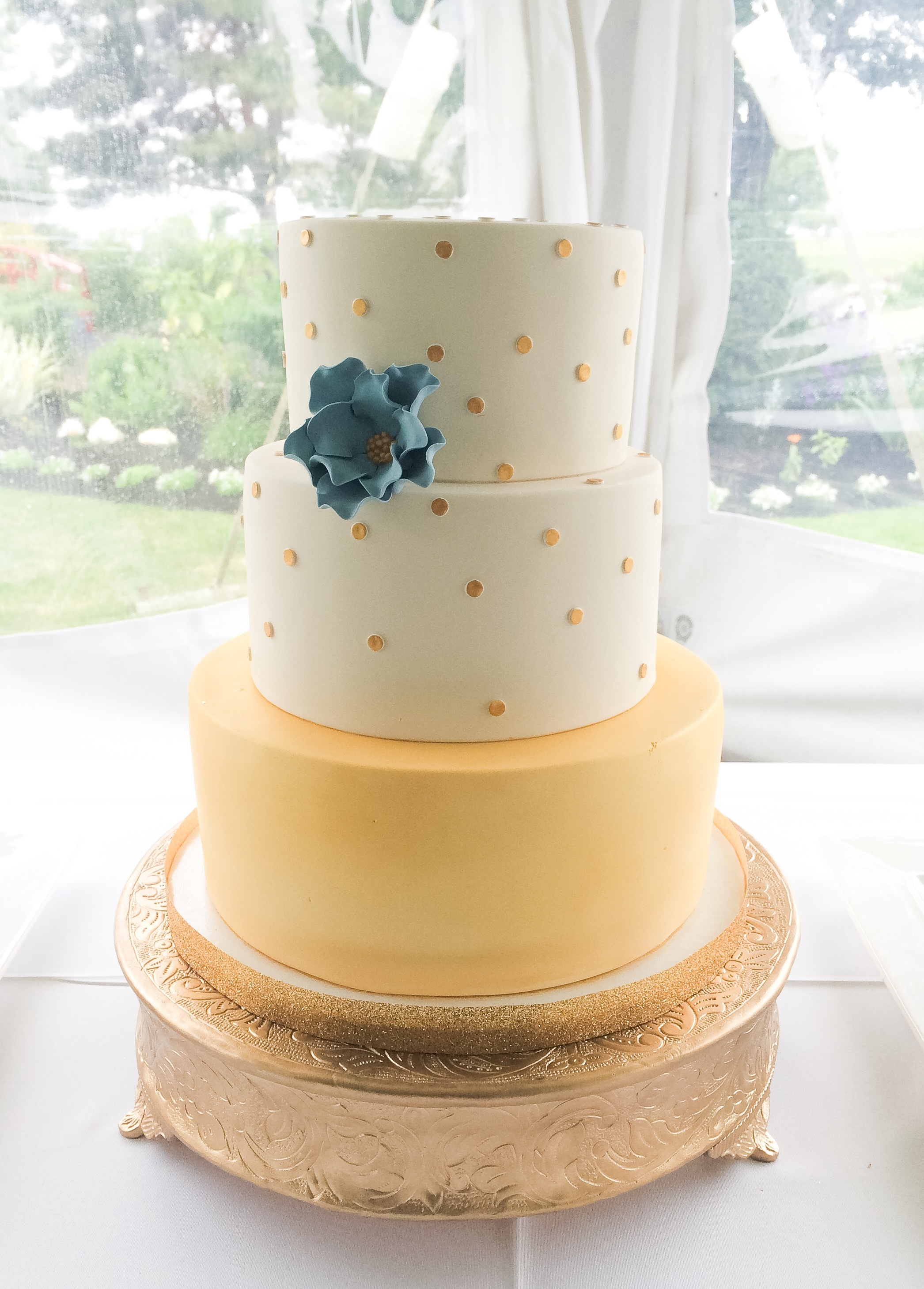 White & gold polka dot fondant wedding cake