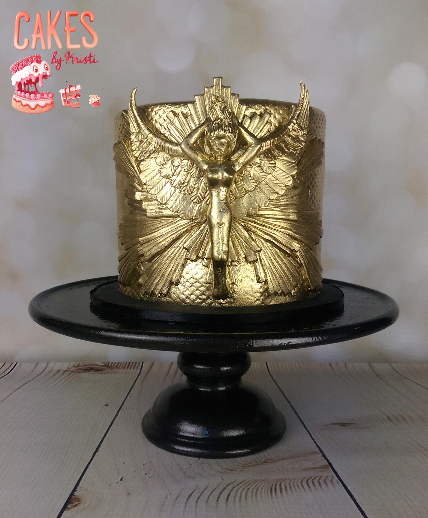 Gold fondant cake with metallic angel