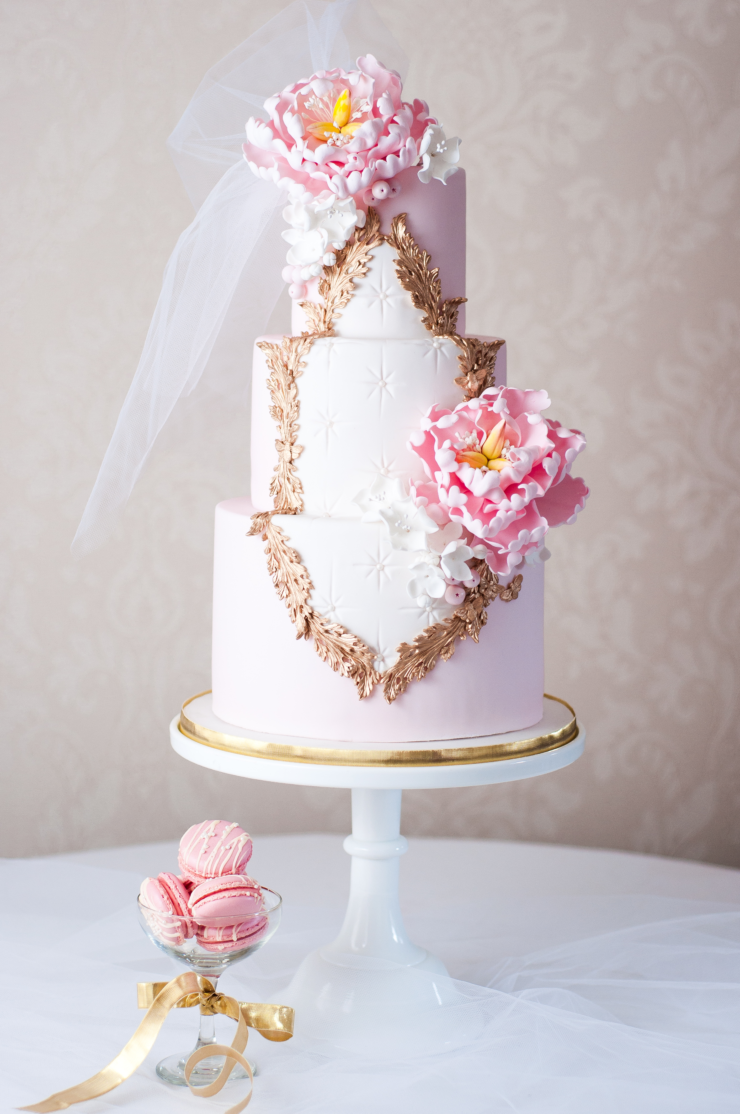 All baby Pink Rococo styled fondant wedding cake